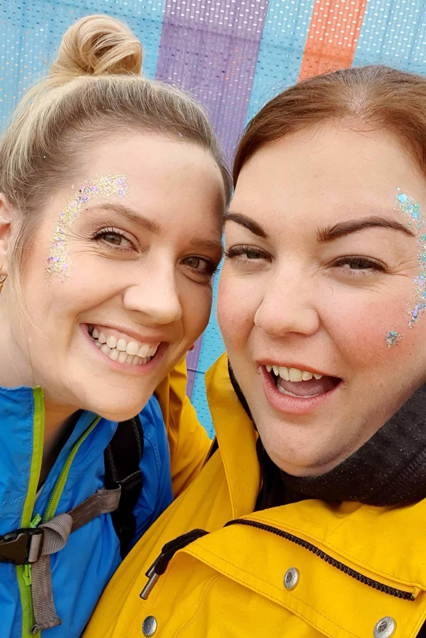 Best friends wearing festival glitter
