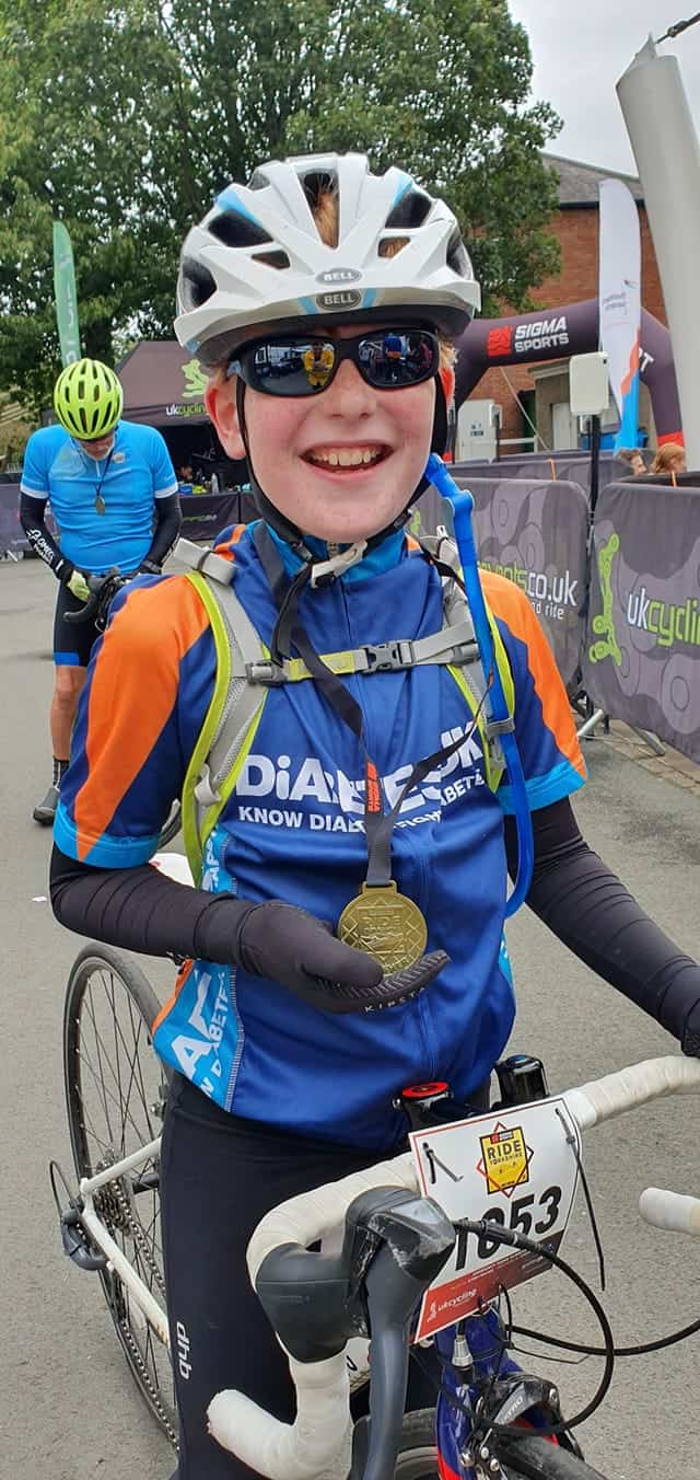 Ten year old boy shows of medal for completing Ride Yorkshire Sportive 2019