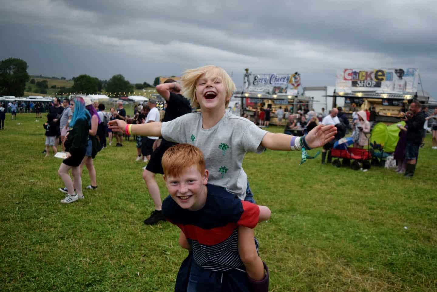 Little girl on her brother's back at YNotFestival