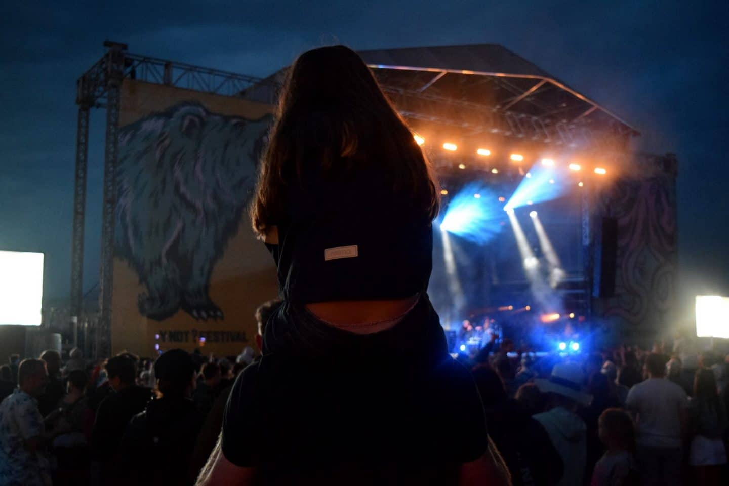 Chloe sat on Dave's shoulders watching Elbow at Y Not Festival