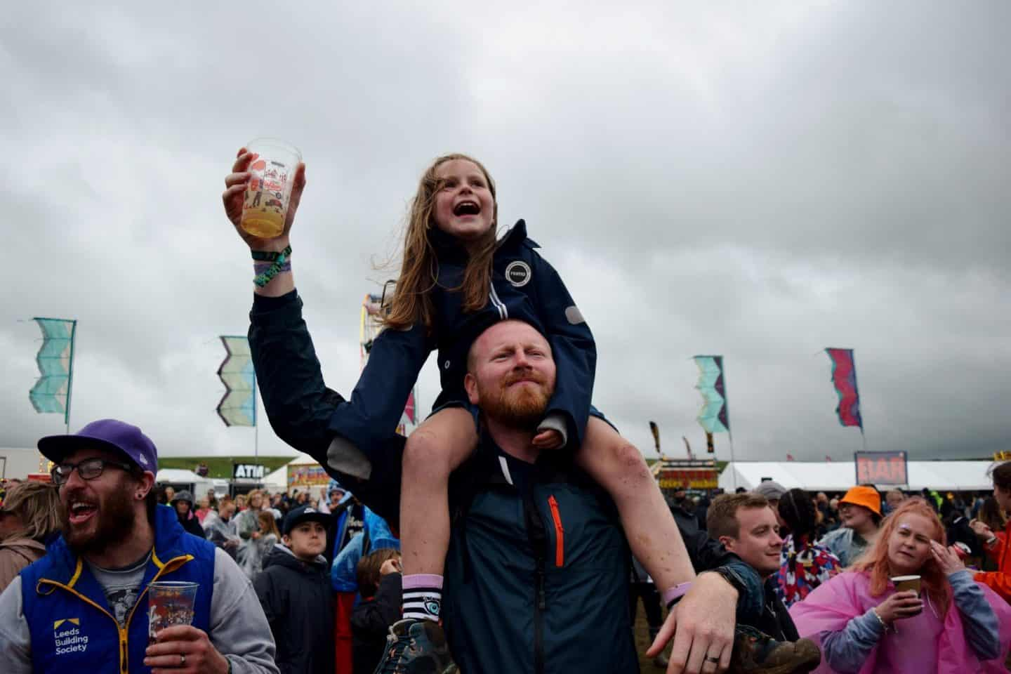 Little girl on her dad's shoulders at Y Not Festival