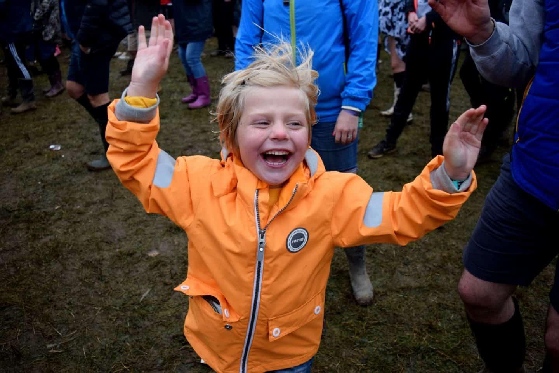 Little girl dancing at a festival