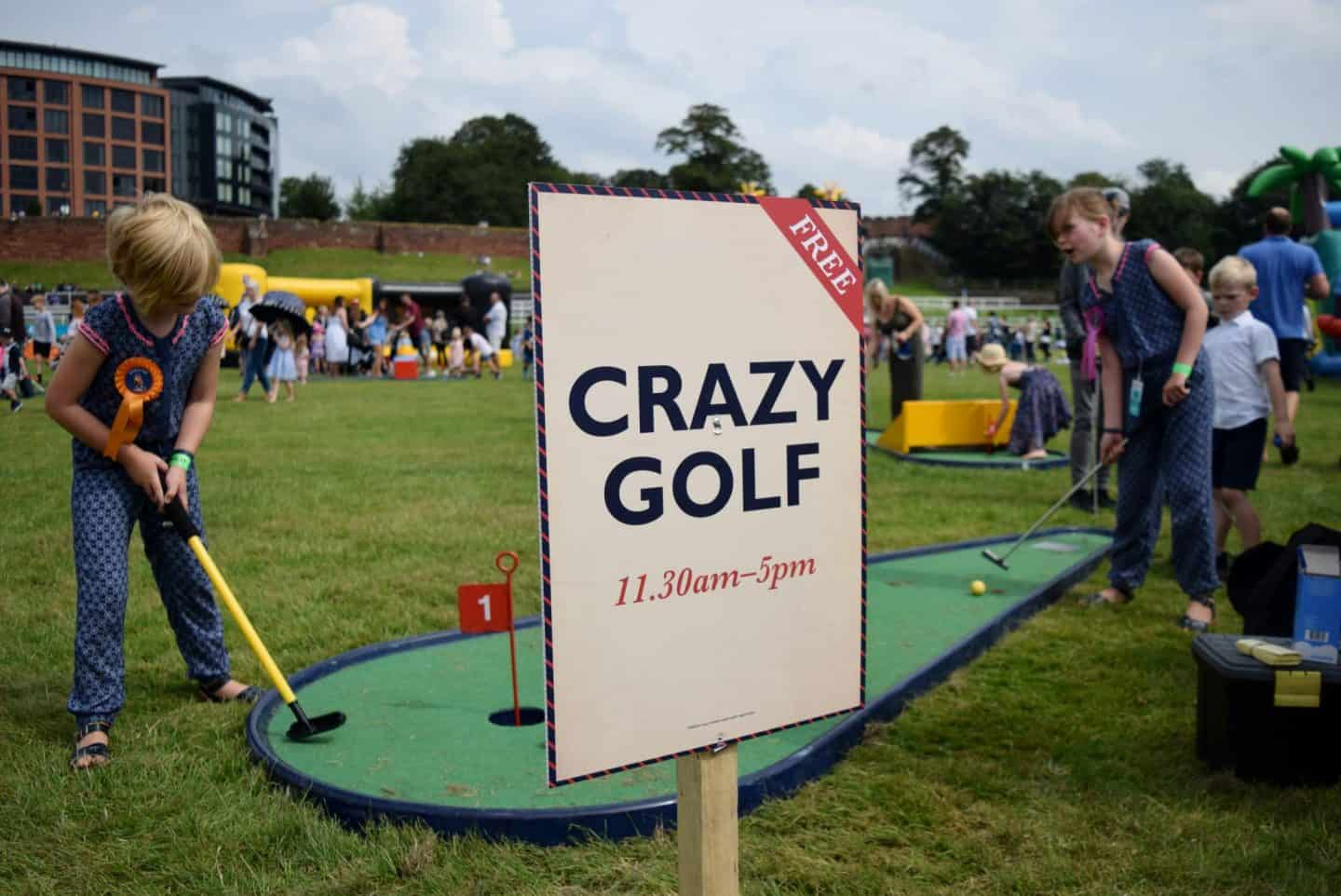 two girls playing Crazy Golf at Chester Racecourse