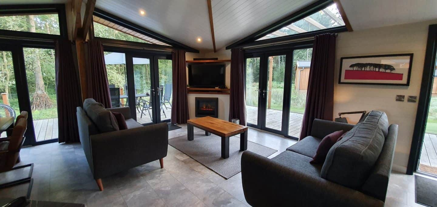 Cosy seating area in Darwin Forest luxury lodge