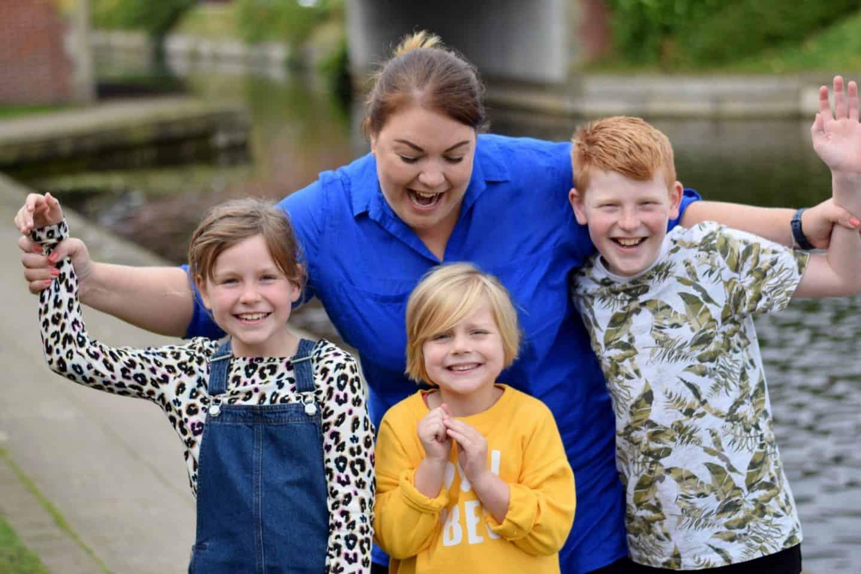 Mum with three children being silly