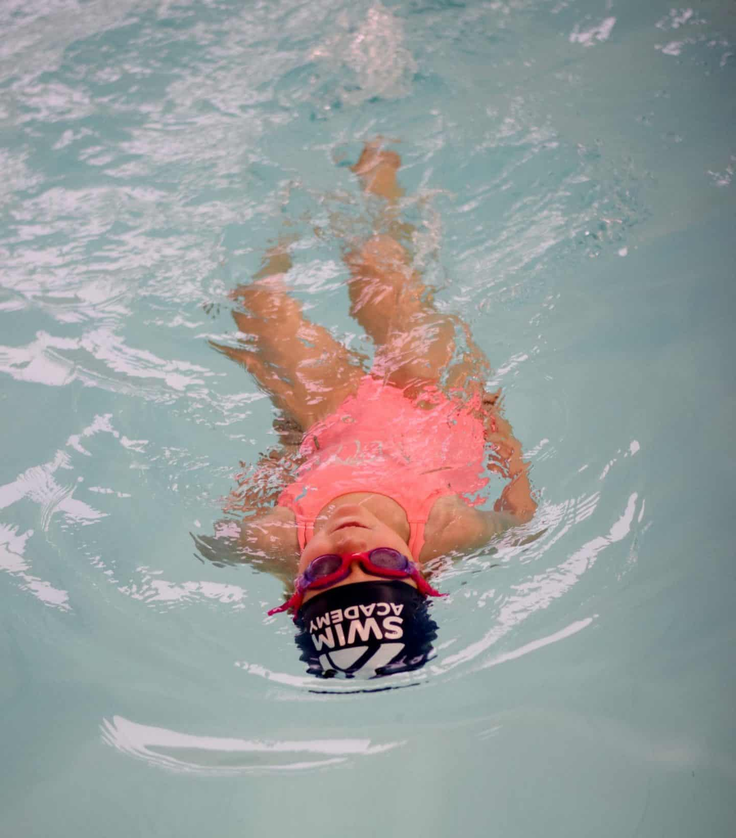 back swims at Swim Academy - fast kicking legs and no arms