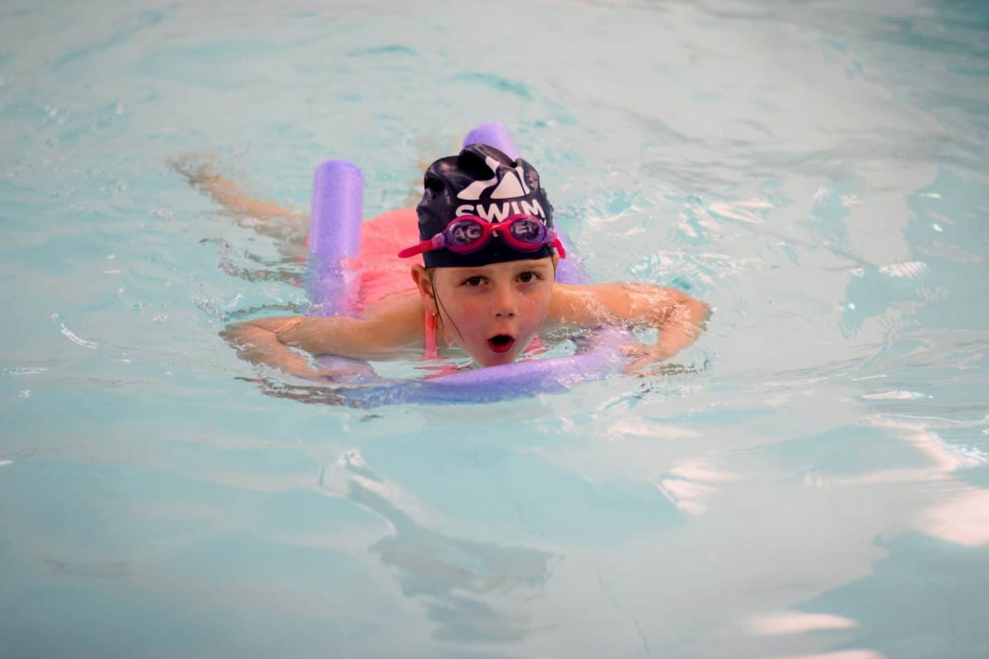 Using a woggle / pool noodle to practice breast stroke legs