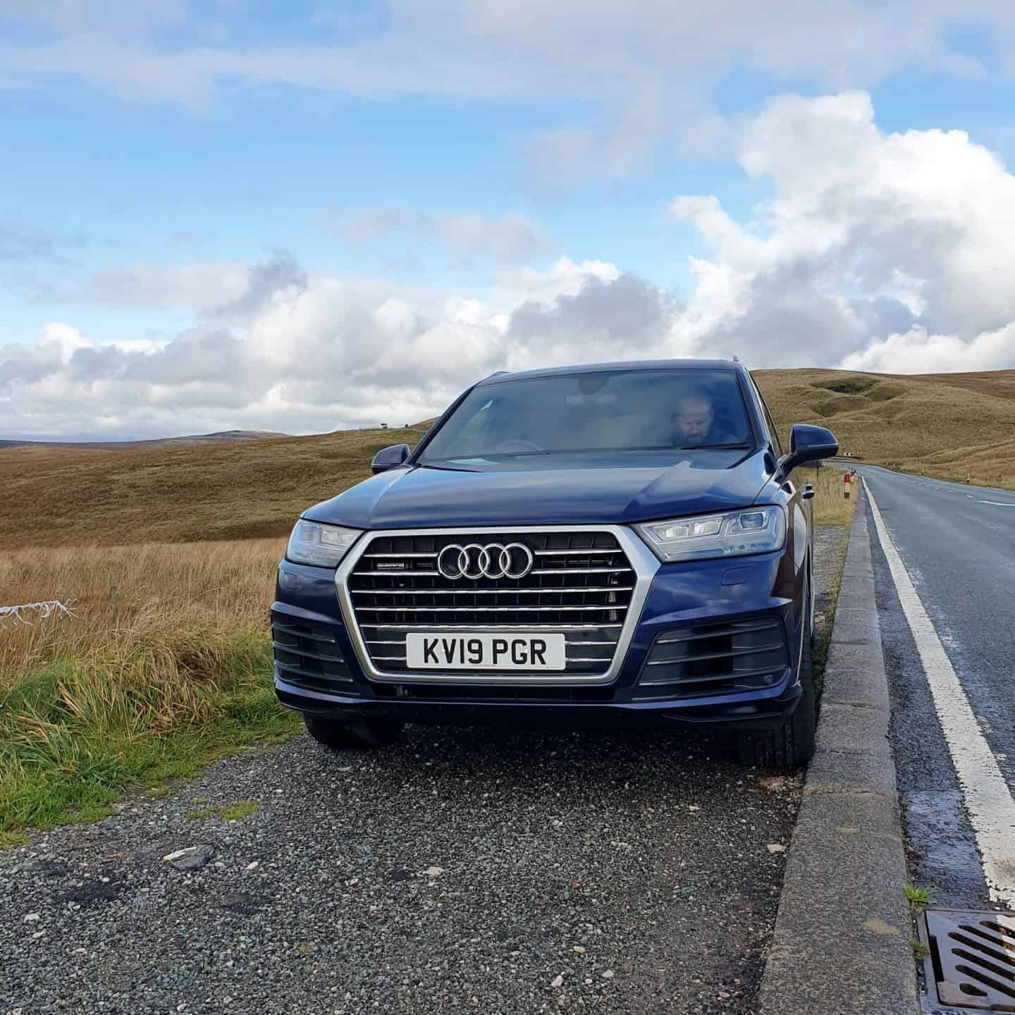 Navy blue Audi Q7 hired for the weekend from Audi on demand Oldham