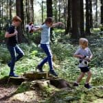 children playing in the woodland at Landal Darwin Forest